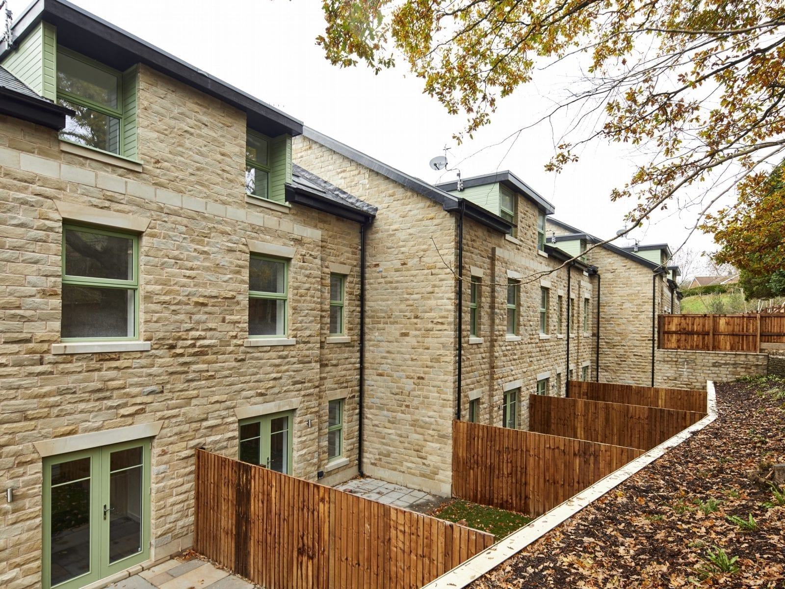 Ingersley Vale, Bollington, Macclesfield,11 townhouses and 1 detached house set in a wooded valley next to the River Dean